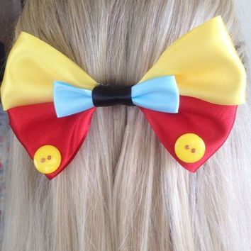 Pinocchio Yellow and Red Puppet Real Boy Bow, No Strings to Hold Me Down by Design Bowtique