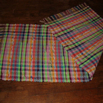 "Loom Woven Rag Rug  24"" x 64""  Brightly colored fabric strips with bright pastel warp."