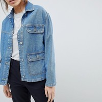 ASOS DESIGN Denim Trucker Jacket In Midwash Blue at asos.com