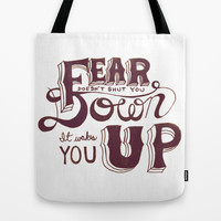 Fear doesn't shut you down; it wakes you up Tote Bag by karifree