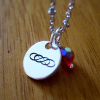 abc's Revenge Inspired Necklace. Double infinity symbol. Emily Thorne pendant. Hand stamped silver colored pendant with a Swarovski crystal.