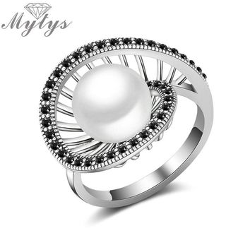 Mytys New Design Geometric Hollow Round Pearl Center Retro Black Marcasite Stone Invisible Setting Antique Pearl Ring R2021
