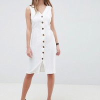 ASOS DESIGN v neck dress with tortoiseshell buttons at asos.com