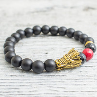 Matte black onyx beaded gold Dragon head stretchy bracelet with a faceted red coral bead,  mens bracelet, womens bracelet
