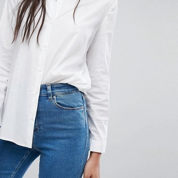 ASOS TALL RIDLEY Skinny Jean In Lily Pretty Mid Wash Blue at asos.com