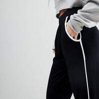 ASOS DESIGN Petite tapered pants with contrast bind at asos.com