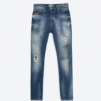 JEANS WITH LEATHER COIN POCKET