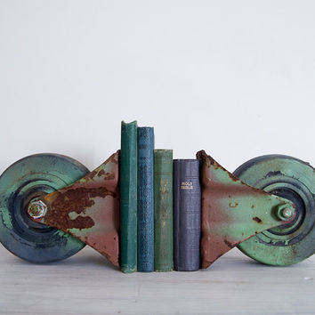vintage industrial green castor set/bookends by epochco on Etsy