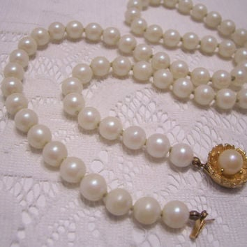 Vintage Faux Pearls With Gold Tone Flower Clip.