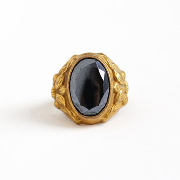 Vintage Art Deco Brass Simulated Hematite Floral Ring - 1930s Size 6 Gray Black Oval Glass Stone Repousse Flower Uncas Costume Jewelry