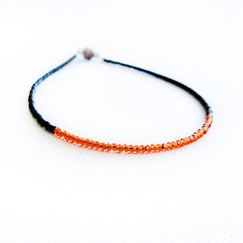 Africa thin seed beads anklet. Black burnt orange beaded tribal minimalist ankle bracelet, color blocking autumn fashion jewelry
