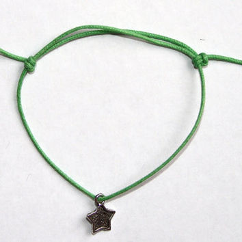 silver outlined star charm on waxed cotton cord adjustable friendship bracelet