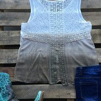 Our Hang On Tight Top - Taupe is a sleeveless top with an ombre effect. The back has embroidery detail and slightly opens towards the bottom. It is not lined and we recommend wearing a cami underneath. Made to be flowy but does run true to size.
