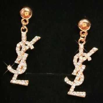 YSL gold letter pearl earrings with big-name earrings, sexy earrings, dramatic earrings and long studs