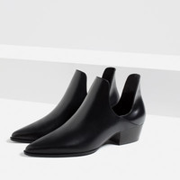 OPEN ANKLE BOOTS WITH HEEL