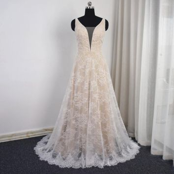 A line V Neck Wedding Dress Ivory Lace Champagne Lining Luxury Beaded Bridal Gown