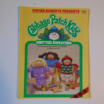 Xavier Roberts presents cabbage patch kids Knitted Sweaters to Crochet