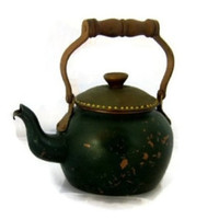 Vintage rustic green copper tea kettle with brown wood handle. Mediterranean decor. Farmhouse kitchen decor.