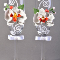Set of handmade wedding wine glasses of white color with polymer clay orchids