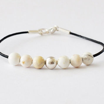 Howlite gemstone Bracelet with silver details, threaded on leather string