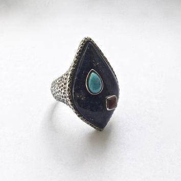 Modernist Sterling Silver Teardrop Shaped Blue Lapis Stone with Turquoise & Ruby Accents set in Textured Hammered Sterling Silver Setting