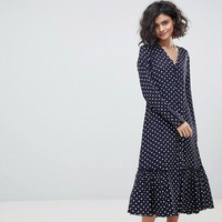 ASOS DESIGN button through midi dress in spot at asos.com