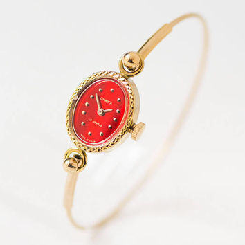 Vintage cocktail watch bracelet Seagull. Unused women's evening watch red face. Oval case classic watch gift. Tiny women watch gold shade