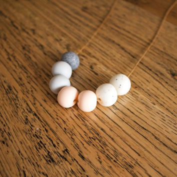 No. 32- Handmade polymer clay beads featuring stone granite, light grey, flesh pink and white granite on waxed brown cord.