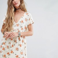 Motel Smock Dress With Lace Up Back In Light Floral at asos.com