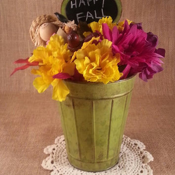 Fall Decoration With Flowers, Scarecrow and Acorn All In A Green Metal Bucket with Chalkboard Sing