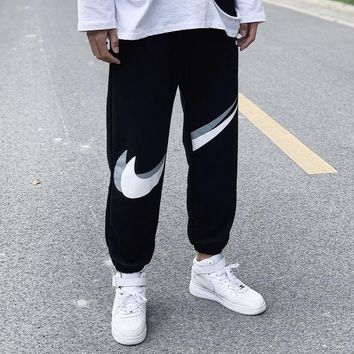 NIKE sports casual pants with broken hook and ankle strap are popular with couples