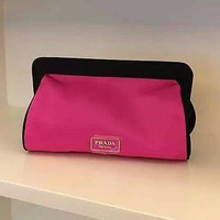 PRADA candy color and large capacity makeup bag can hold the bag and hold the bag for dinner