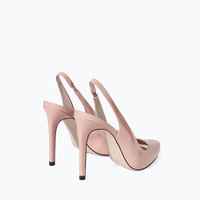 Sling back shoes with high heel