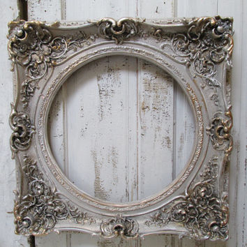 French Nordic antique style frame large ornate golds, pewters and distressing 26 by 26 wall decor Anita Spero