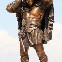 Bronze Statue of HERCULES by Chris Ingram shows the Thracian Wars Hero putting on the lion's head and pelt