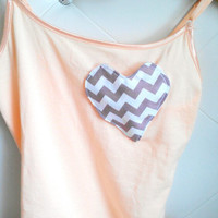 Gray heart pocket on soft coral shirt
