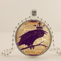 """Crown with black bird. 1"""" glass and metal Pendant necklace Jewelry."""