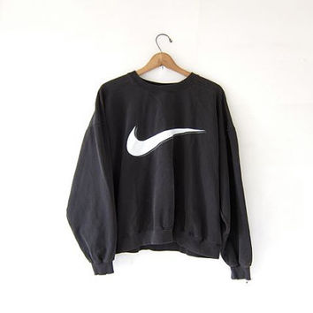 vintage NIKE coed sweatshirt. faded black sweatshirt. boxy loose fit slouchy sweatshirt. lightly distressed