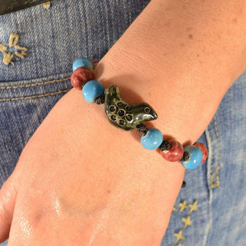 Bracelet with ceramic beads black bird and blue and brown round beads