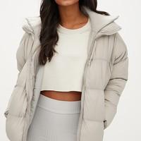 Taupe Oversized Puffer Jacket with Zip Pockets