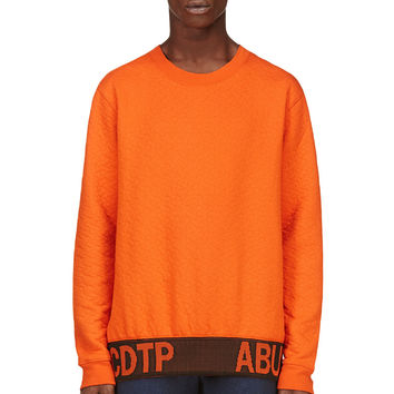 Raf Simons- Sterling Ruby Orange Quilted Sweater