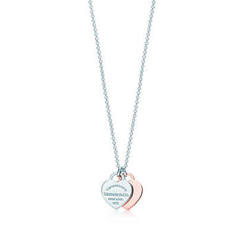 Tiffany & Co. - Return to Tiffany™ double heart pendant in RUBEDO® metal and silver, mini.