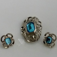Vintage  Earrings and  Brooch  Avon Baby Blue Emerald Cut Rhinestone and Silvertone Brooch and matching Earrings