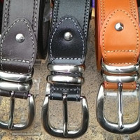 Tan leather man's belt tiger tail