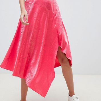 ASOS DESIGN pink snake jacquard midi skirt with asymmetric hem at asos.com