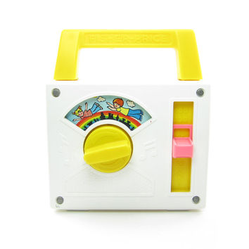 Fisher Price Radio Over the Rainbow Wind Up Musical Pocket Toy