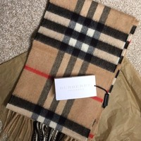 Brand new children's Burberry Scarf, original packaging and labels attached.