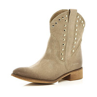 Beige studded western ankle boots