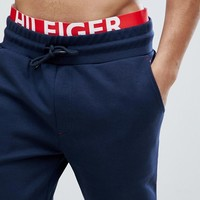 Tommy Hilfiger Cuffed Joggers Contrast Inner Waistband in Navy at asos.com