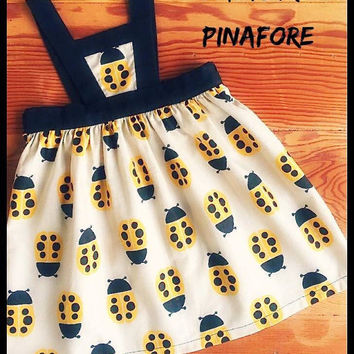 Ladybird pinafore dress available in sizes newborn - 6yrs linen yellow black bugs retro